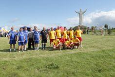 Parish football team at the figure of Jesus Christ the King
