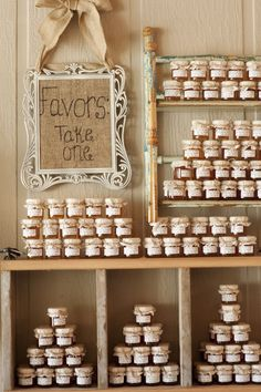 a cute way to display favors. i'm thinking of bbq rub or jam if we're doing bbq for the dinner. i could use vintage crates standing up for the same effect.