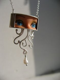 Looking like a cross between pop art and a doll-parts massacre, these unique earrings and pendants from Margaux Lange certainly will make a statement. They're carefully cobbled together from … Mens Gold Jewelry, Resin Jewelry, Jewelry Art, Unique Jewelry, Vintage Jewelry, Handmade Jewelry, Jewelry Accessories, Found Object Jewelry, Doll Parts