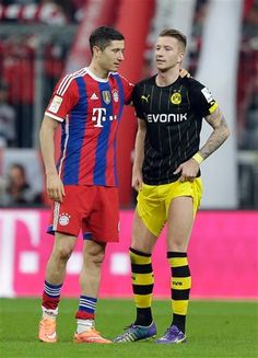 Robert Lewandowski of Bayern Munich and Marco Reus of Borussia Dortmund