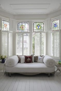 White slatted shutters and stunning stained glass #LoungeInspiration