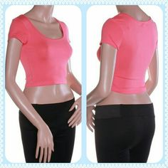 *Coral crop top* A great top with high waisted pants or skirts! This piece works as a layer under an open sweater for a fun pop of color as a stand alone top.  It does sit a touch higher than it looks on the mannequin and is a junior size small. Ambiance Apparel Tops Crop Tops
