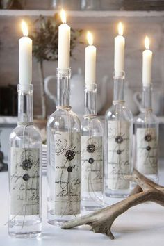 Use scrapbooking paper on wine bottles and make pretty candle holders