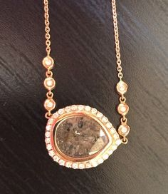 Diamond slice pendant accented with a rose gold diamond halo from Craft-Revival Jewelers #diamondnecklace #diamondslice #rosegold #diamondhalo