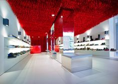 30,000 shoelaces hang from Melbourne Camper store ceiling. Marko Brajovic