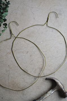 metal coat hangers hammered into wreath bases // juliettelaura.blogspot.com