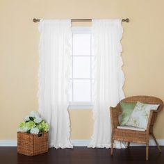 Soft and feminine ruffles are a gorgeous addition to any roomAllows natural light to flow through the room while providing some privacyContent: 100% Cotton VoileClassic rod pockets create a clean and tailored look on a standard or decorative rod.Measurement : Each panel measures 52