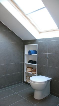 in built storage into loft bathroom but in different position to allow for basin