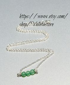 Green Aventurine 6mm and sterling silver Necklace  Ask a Question $25.00 USD Only 1 available Overview Handmade item Materials: Sterling silver chain, 6mm Aventurine Stone Feedback: 2 reviews Ships worldwide from Fort Worth, Texas This shop accepts Etsy Gift Cards