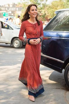 The Duchess of Cambridge wore a £50 Indian-inspired maxi dress by Manchester-based self-proclaimed fast fashion label 'Glamorous' to visit street children at New Delhi's main railway station.
