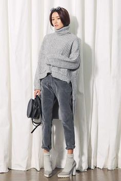 Stylenanda Front Pocket Dipped Hem Turtleneck Knit TopThis turtleneck top lends warmth and game-changing look. With long sleeves, dipped hem, two patched pockets to the front, and an overall relaxed fit. Wear with corduroy pants and heels for a pleasant, chic finish.