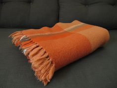 This blanket is a beautiful coral/salmon orange with deeper more vibrant oranges and creamy softer oranges contrasting it. Other colors are off
