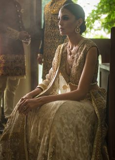 Ivory and gold plunging neckline blouse in gold lame styled with lehenga in sheer jacquard organza with beautiful hand embroidered ghair and intricately hand worked shawl. Pakistani Lehenga, Indian Bridal Lehenga, Pakistani Bridal Wear, Pakistani Bridal Dresses Online, Bridal Dresses 2017, Victor Hugo, Bridal Dress Design, Bridal Style, Pakistan Bridal