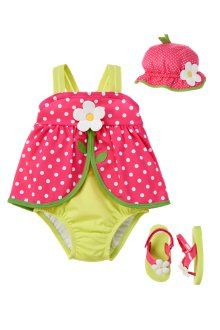 Sweet dots for swim days. Our super cute swimsuit is complemented by a matching sunhat and cute flip flop sandals