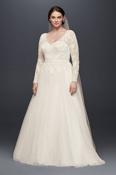 Illusion mesh sleeves strike a lovely balance between covered and bare, particularly when paired with a flattering, wide-set V-neck and low back. The A-line tulle skirt adds a softly voluminous finish