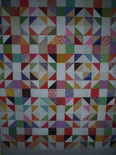 Click to view large image                            1/2 square triangle scrap quilt