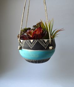 T R I B A L : ceramic hanging planter by mbundy on Etsy https://www.etsy.com/listing/231353125/t-r-i-b-a-l-ceramic-hanging-planter