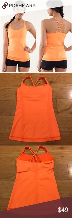 Lululemon 'Free To Be' Tank Lululemon 'Free To Be' Tank in Pizazz. -No tag/size dot, but size 2. -Bright orange color. -Built-in-bra, includes removable cups. -Like new condition!!   NO Trades. Please make all offers through offer button. lululemon athletica Tops Tank Tops