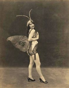 girl-dancing-high-in-the-sky- with-butterfly-costume-1920s