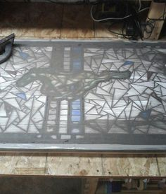 Grouting Mustang Table. TouVelle Stained Glass. Lincoln, Ne.