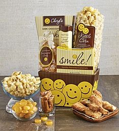 All Smiles Sweets and Treats Gift Basket   1800Baskets.com   Send a smile to someone special with this adorable gift that's sure to put a smile on their face and make them grin from ear to ear. This colorful, collectible box is bursting with delicious gourmet sweets and treats including Cheryl's Chocolate Chip Cookies, Creamy Vanilla Caramels, rich Butter Scotch candies, a cinnamon twist pastry, and The Popcorn Factory® Kettle Popcorn .