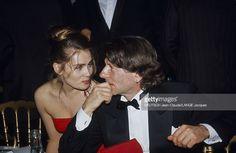44th Cannes Film Festival 1991. Le 44ème Festival de CANNES se déroule du 9 au 20 mai 1991 : Emmanuelle SEIGNER souriante assise à table aux côtés de son mari Roman POLANSKI de profil, portant une boucle d'oreille (il est le président du jury).