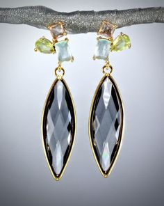 7c4729698ae7 Faceted marquise-cut cubic zirconia hang from posts in pastel shades with a  chic geometric vibe. The whole ensemble creates an intensity of colors .