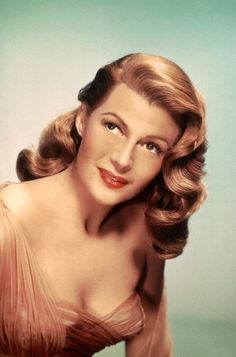 """Rita Hayworth is a classic beauty & redhead, as well as an icon of the 1940's. To get her look, we turned to New York City makeup artist,Sarah Salice. """"When thinking of her three things come to mind: lashes, lips, & skin,"""" said Salice. """"Rita's makeup is not over-the-top or dramatic. She was a natur"""