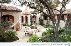 A courtyard garden with multi-color clay tiles, brick and stone designed with a traditional approach.