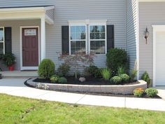 Could build up our one side that goes downhill so that it's even with the other side (like in this picture). Low Maintenance Front Yard Landscaping | Front Yard Landscaping WNY | Serene Gardens