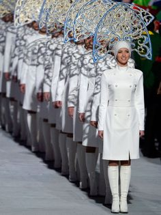 Official escorts stand ready to accompany the flag bearers of the competing nations at the closing ceremony. #sochi2014 #olympics #winterolympics