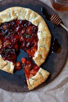Apricot Cherry Galette | 2 1/2 cups all purpose flour, 8 oz of butter,  1/4 cup of cold water, black velvet apricots and black cherries or any stone fruit, 1 tablespoon of thinly sliced sweet basil, 1/4 of corn starch and 1/2 cup of honey, egg wash, raw sugar, corn syrup.