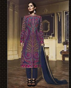 Blue sherwani style suit with multicolored thread embroidery   1. Navy blue silk sherwani style festive suit2. Highlighted with multicolored resham embroidered with rhinestones3. Shantoon lining 4. Georgette dupatta embellished with rhinestones with shimmer lace 5. can be stitched up to size 42