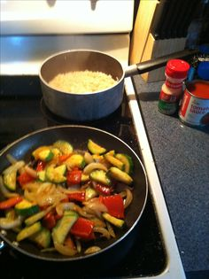 Daniel Fast Recipe- sauté a zucchini, a red bell pepper and a green onion with olive oil and garlic powder. Put over brown rice. Pour tomato sauce over veggies to top it off.. Delish!