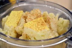 Forget the carb-y potatoes.  Mashed garlic cauliflower is just as delicious and much better for you (anti-cancer).