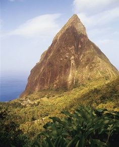 Voted the number one hotel in the world by our readers in 2005, St. Lucia's Ladera has open-air rooms built atop a ridge overlooking the Pitons and the sea