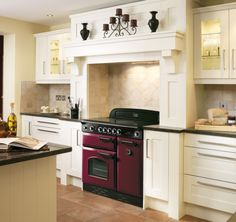 Rangemaster Classic 90 range cooker in cranberry (dark red) and chrome. Shown in a cream kitchen.