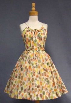 A pretty 1960's cocktail dress in cream nylon chiffon with olive, brown, orange and yellow polka dots.