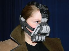 How good was Dark Knight Rises? So good that bad man Bane gets his mask remixed in wool by Etsy seller Stitchfinder General; the same shop that brought us the Wearable Facehugger!