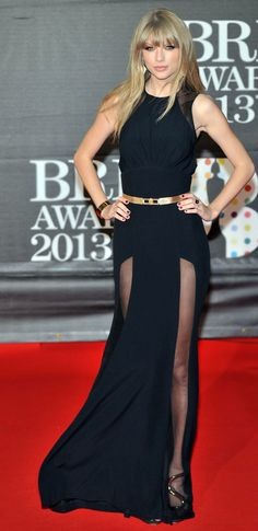 Taylor Swift stunning on the Red Carpet in this stunning long black dress with sheer panels. Love the accessories too.