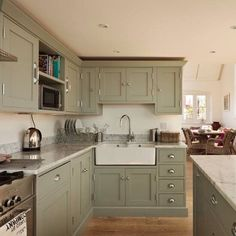 Farrow & Ball's Pigeon on the cabinets, paired with a warm blush pink on the walls