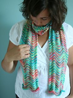 "Here's that Chevron scarf again....    Knit from Knit Picks Sock Memoreis yarn in ""paper dolls"" and ""hawaii"" on size 5 bamboo needles. The pattern is from Joelle Hoverson's ""knitted gifts"" book."