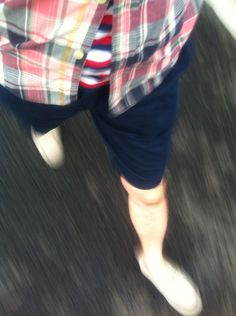 plaid on stripe, navy shorts and suede driver.