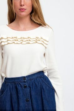Des Petits Hauts offers a girly update to the classic sweater by giving this cream design ruffles on the front and tiny gold-tone buttons on the back. Style yours with sophisticated trousers and downtime denim alike. By Des Petits Hauts.  Available at Sienna & Faye.