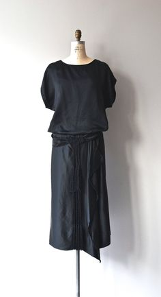 Vintage 1920s black silk dress, minimalist with split-sleeve tunic top, dropped waist with truly great corde/soutache tassel detail and low cummerbund