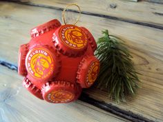 Recycled Bottle Cap Ornament - Quirky Holiday Decor - Fat Tire Bottlecap Decoration - Upcycled Christmas Tree Ornament - Beer Lover Gift. $8.00, via Etsy.