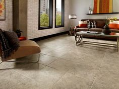 Luxury Vinyl La Plata - Taupe/Gray Urban living has never been more inviting! The modern décor and earthy color palette work in cozy harmony with this Alterna floor. The soft, neutral color of natural limestone gives this floor a timeless appearance.