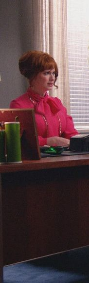 Joan Harris looked all office-ready in her pink bow blouse on Mad Men.