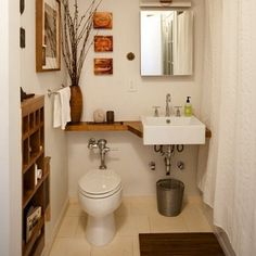 Building a simple custom shelf over the top of the toilet adds an eye-catching design element in a small bathroom