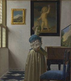 A Young Woman standing at a Virginal - Johannes Vermeer — Google Arts & Culture